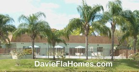 Clubhouse and pool at Villas of Arista Park in Davie FL